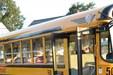 A school bus drops students off at OLSH.