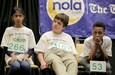 Vaishu Kumbala, 2nd place, Alexander Drewitz, 3rd place, and winner Thomas Gross III wait for another round to begin during the final competition of the 30th annual Spelling Bee Saturday (March 17) at Xavier University.