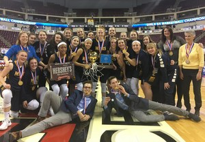 Mars Area High School Girls Basketball Team  poses for a picture with their first place PIAA Class 5A Trophy
