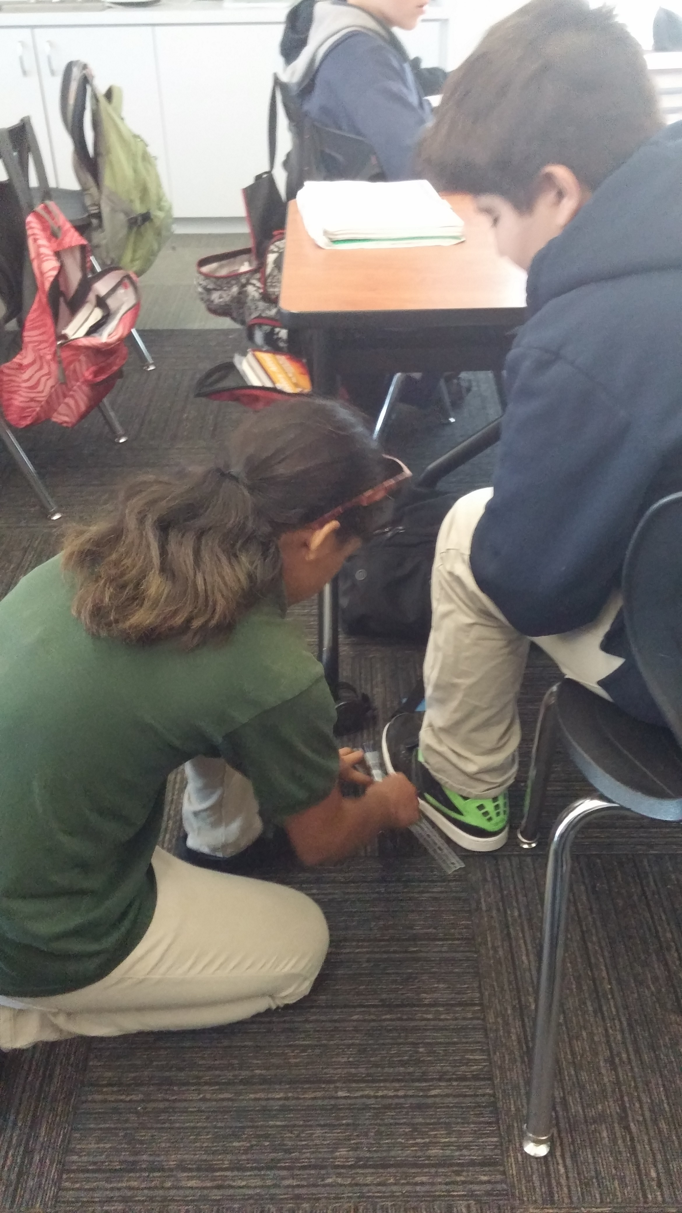 The seventh graders were busy measuring each others' feet and height this week for a lesson on Line of Best Fit.