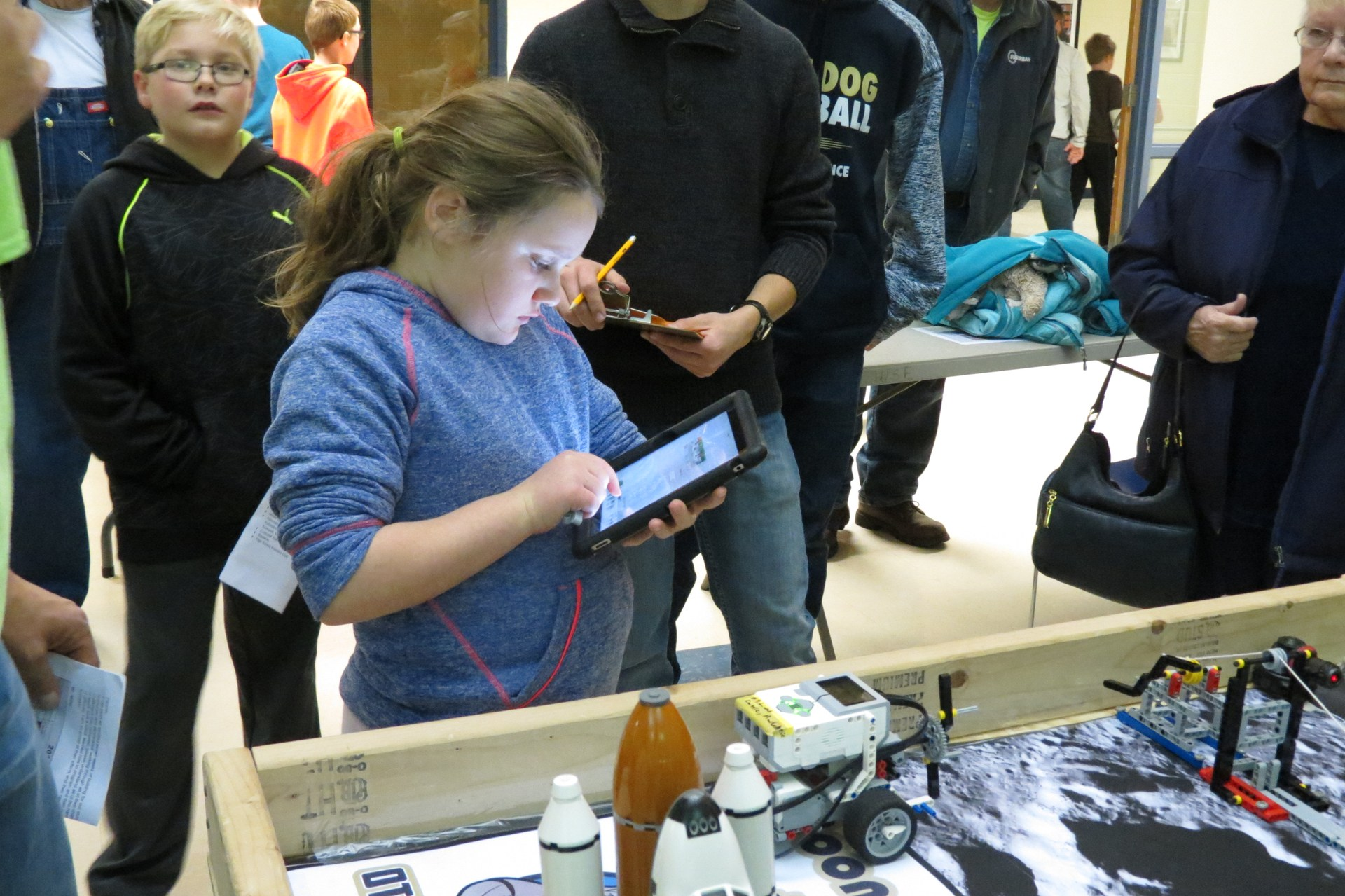 A student works on the programming of her robot at the final challenge.