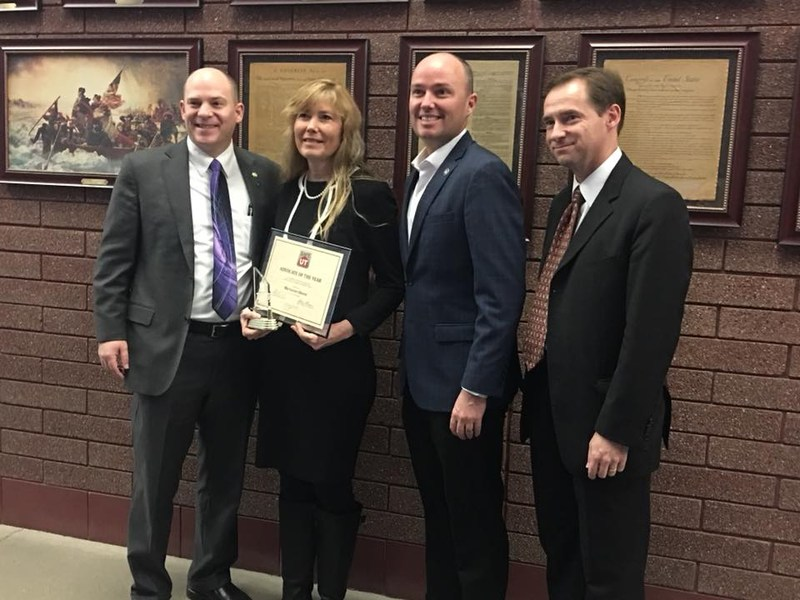 Director of Counseling and Social Services, Marianne Oborn, receives the Advocate of the Year award