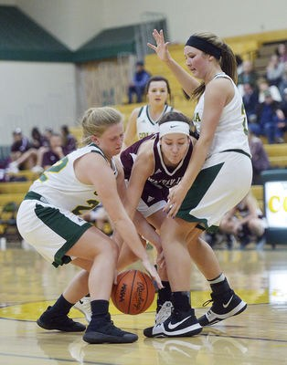 Coloma girls basketball players put the squeeze on a Watervliet player earlier this season.