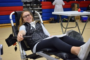 Girl donating blood.