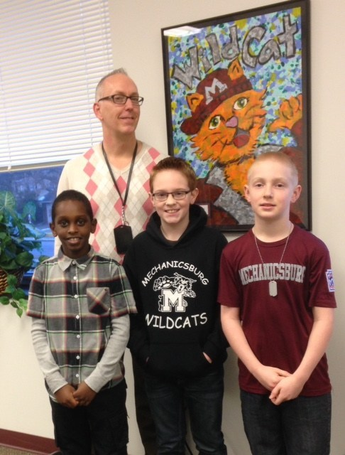 Mr. Mitchel and Students standing next to a painted Wildcat