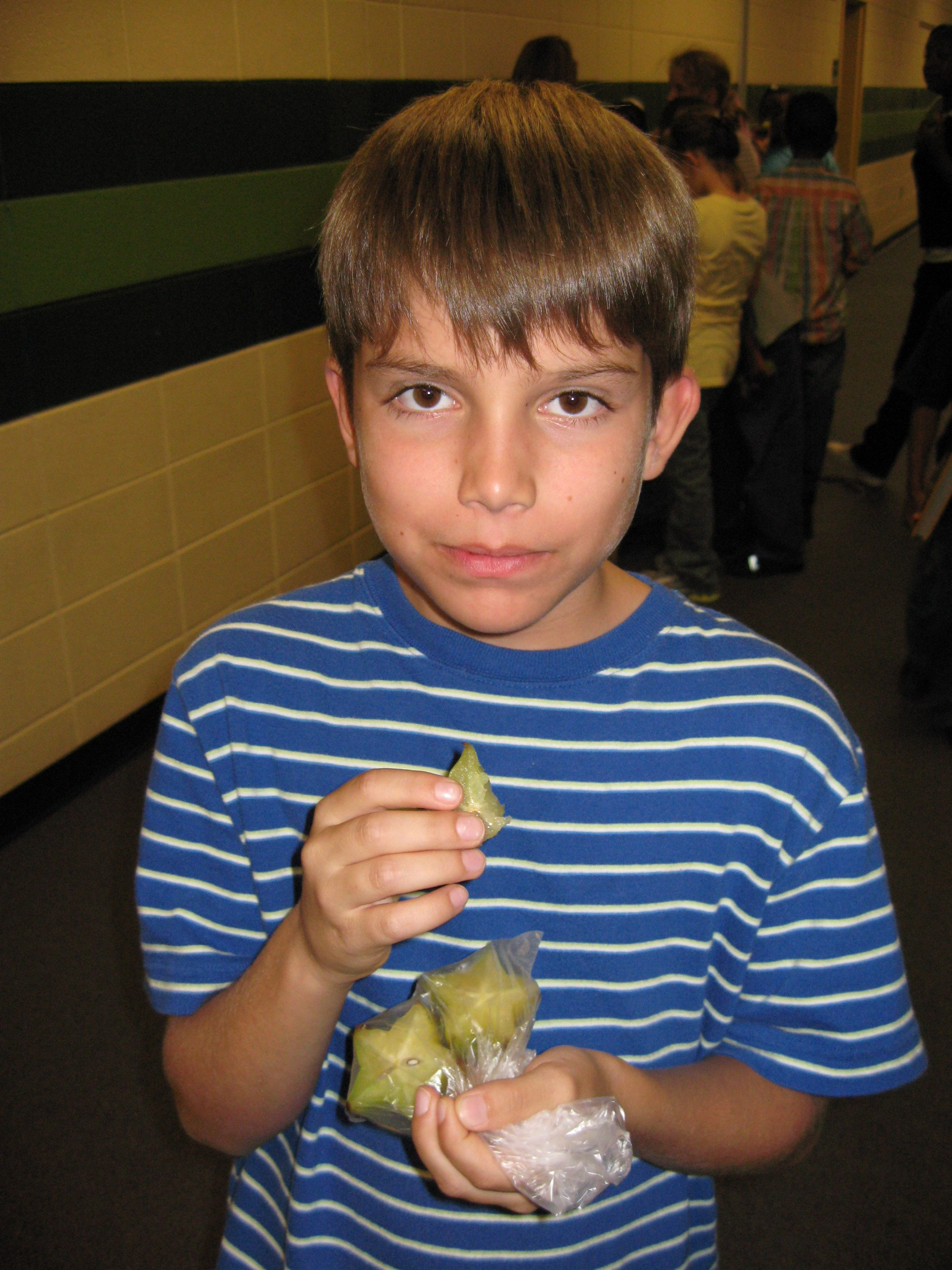Student holding fruit