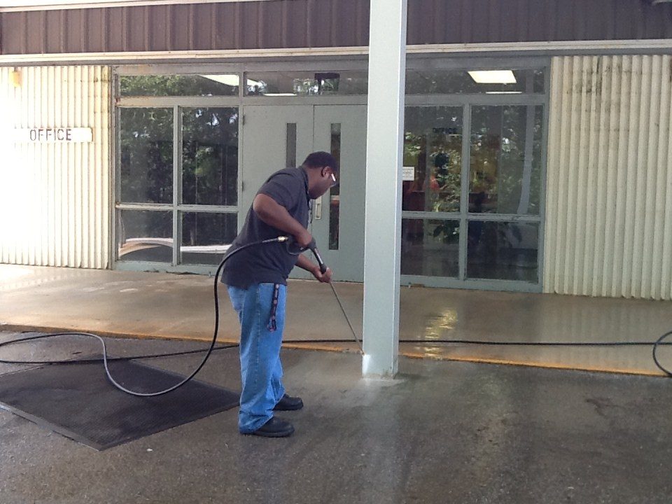 Ag student pressure washing.