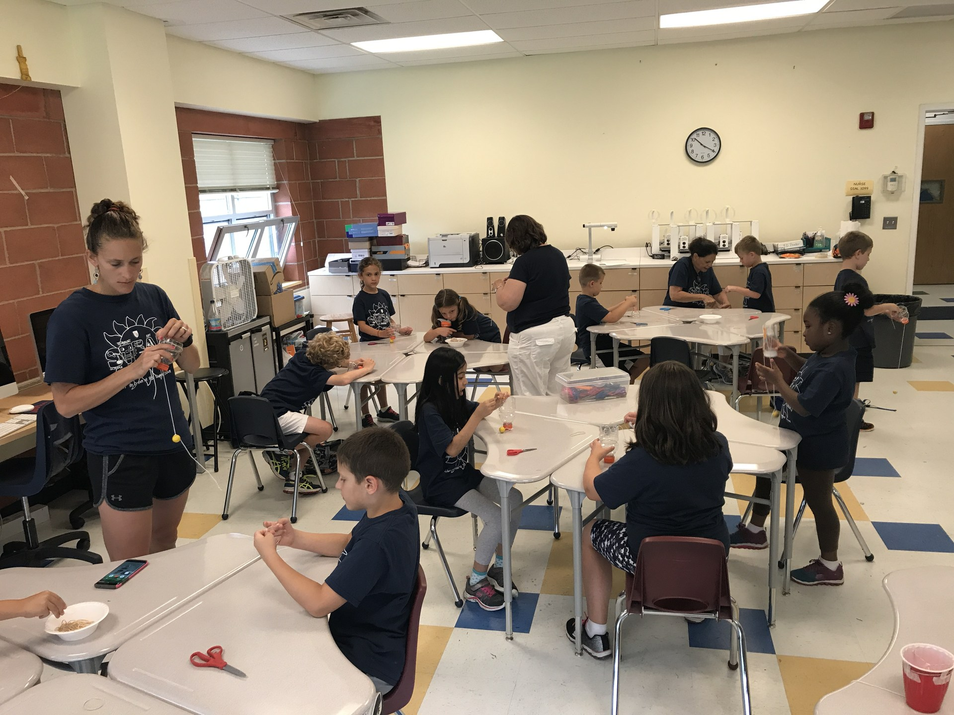 Students perform experiment during Summer STEAM