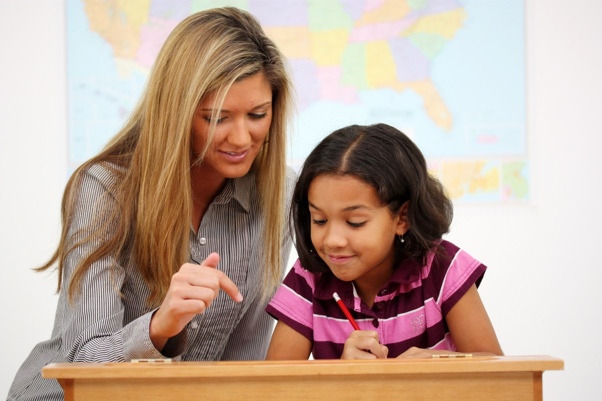 Teacher with student working