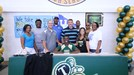 CJ Hawkins with his coaches and family members