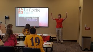 OLSH alumni and La Roche professor Dr. Becky Bozym '97 speaks with students