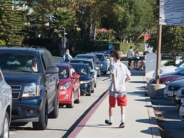 Drivers line up to get their cars washed by PVHS AVID students