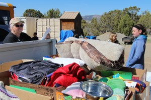 Image of donated items in bed of truck.