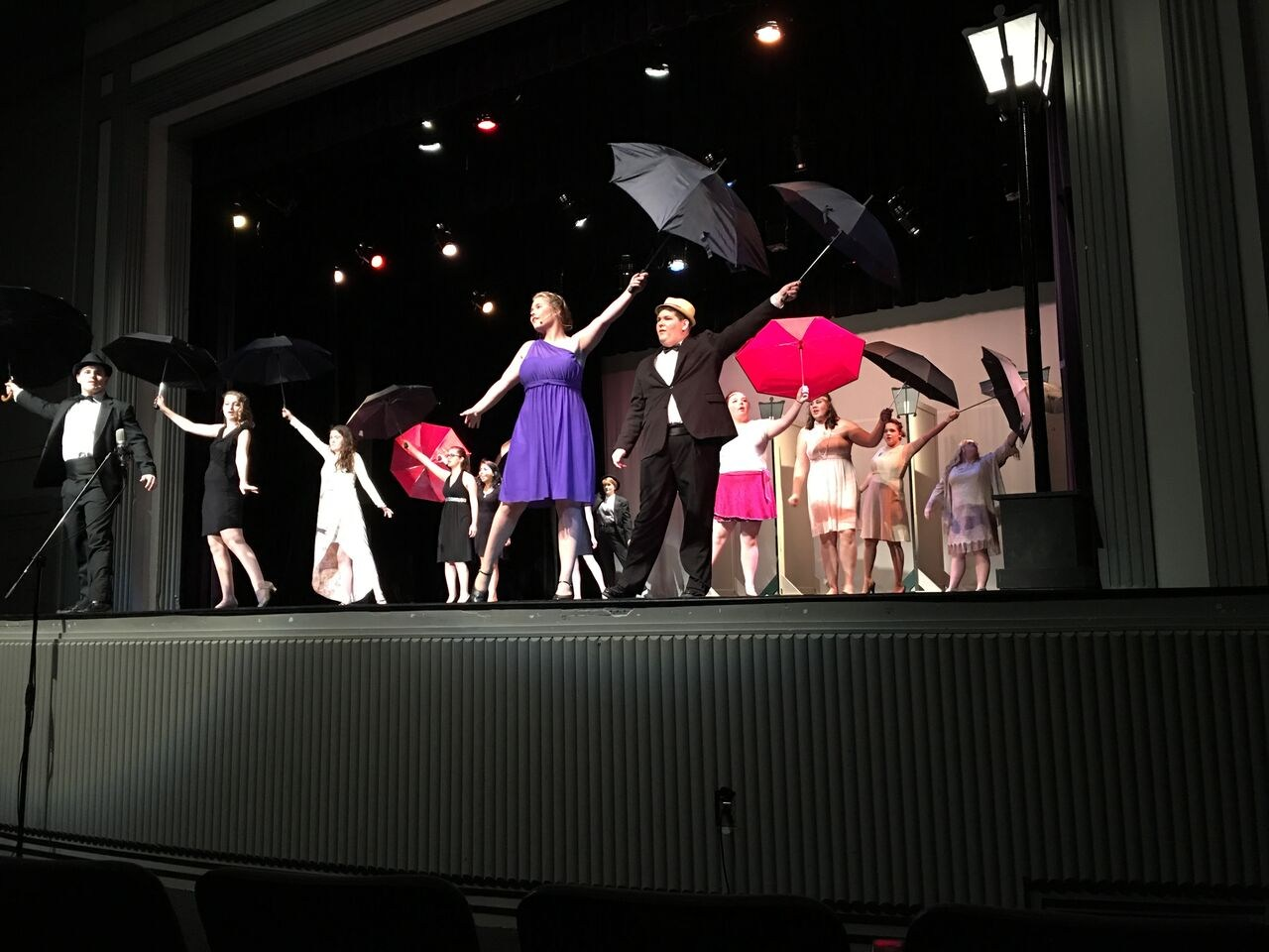 Drama students performing 'Singing in the Rain'