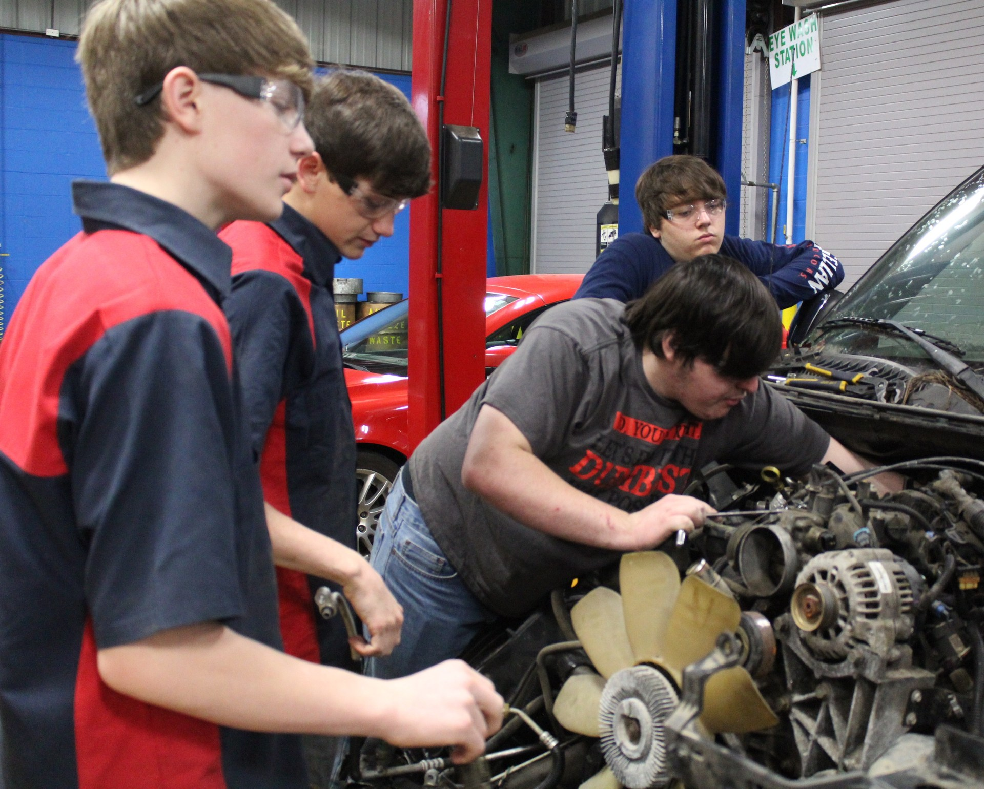Auto students in the shop.