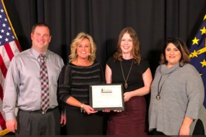 Picture of WHS Principal and 2 teachers receiving an award from state superintendent