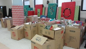 Cardboard boxes filled with Christmas presents