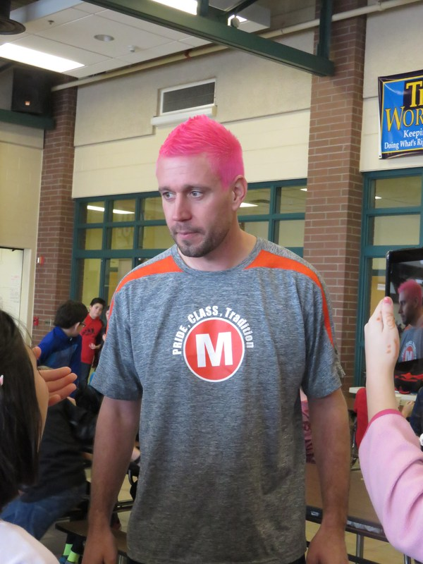TKMS Principal Brian Balding lets students chose the color of his hair after a challenge.