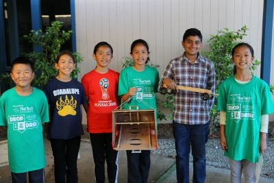 Guadalupe students holding up their tech challenge device