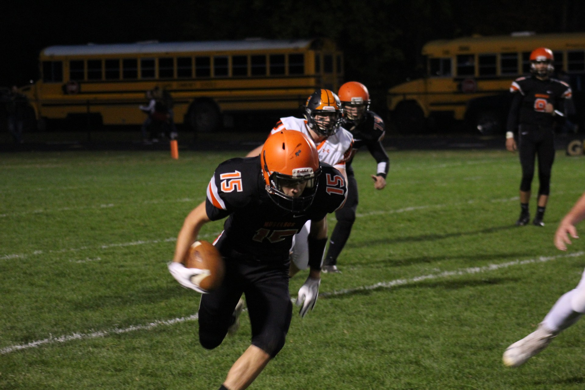 Photo of Clio football player running with the ball toward the camera