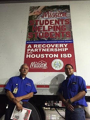 Our two drivers who took the 18-wheeler to Houston ISD.