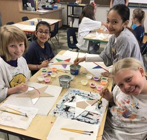 Third graders designing Stars of Hope with assistance from Rotary Club members