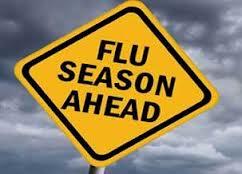 Caution sign that reads Flu Season Ahead