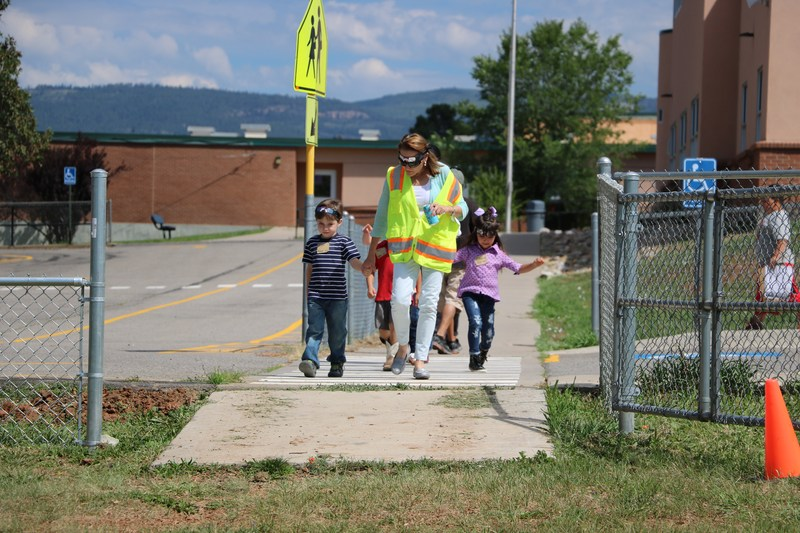 Students and teacher crossing street.