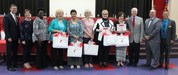 Image of board members with five retirees honored at April 20 meeting.
