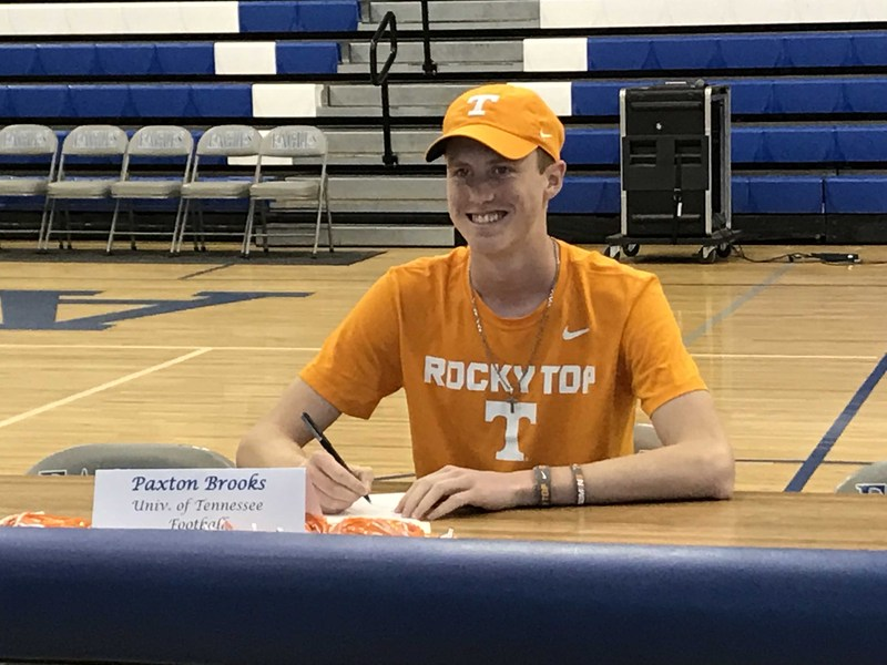 picture of Paxton signing