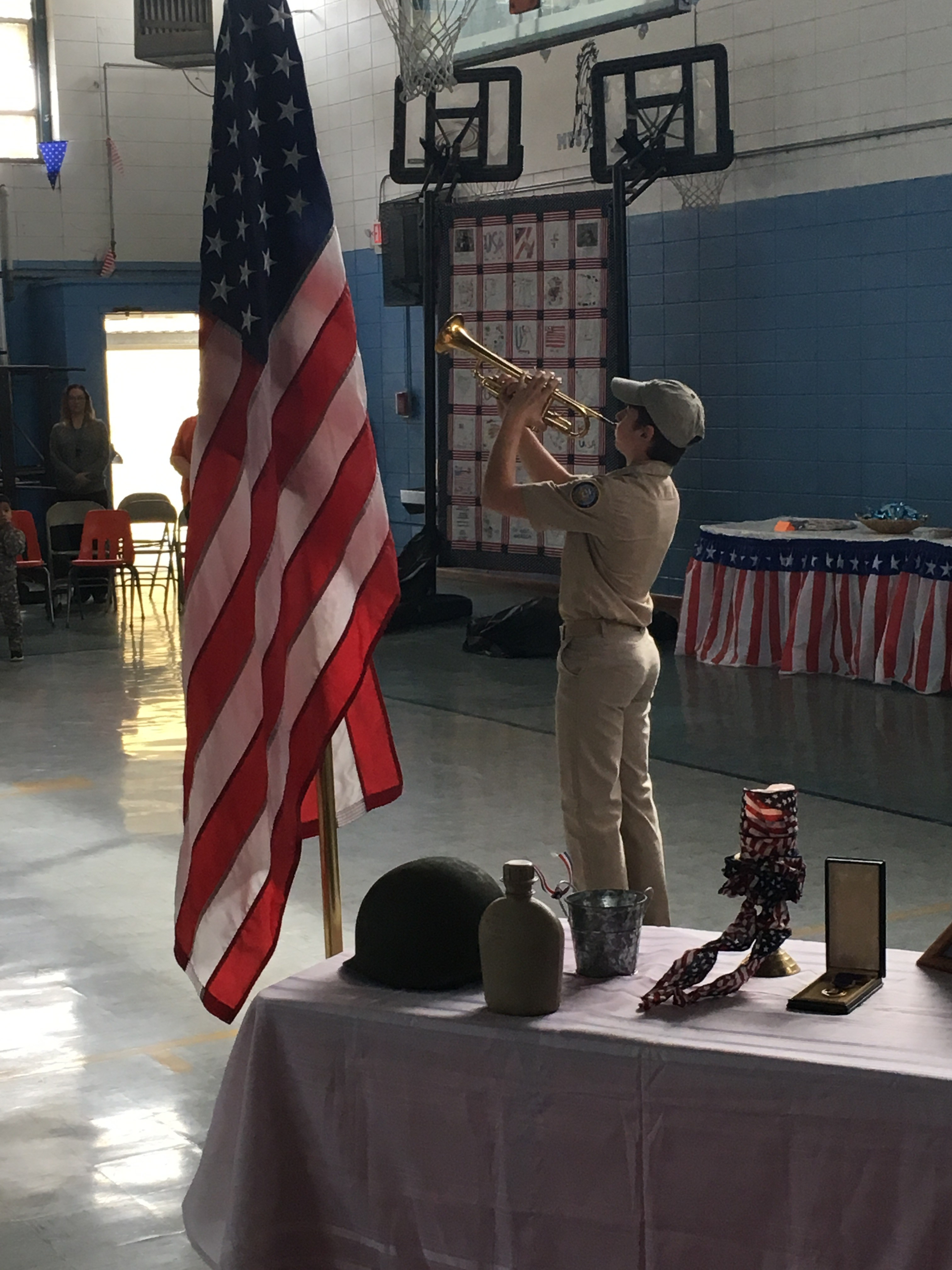 Cadet playing Taps at the Veteran's Day Program
