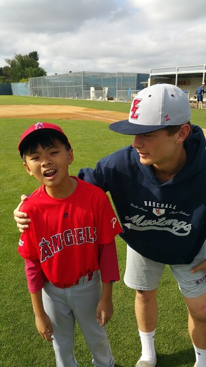 YLHS player posing with a pony league player
