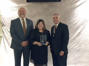 Oakland Principal Bill Spurlock, RCS Career and Technical Education Coordinator Tyra Pilgram and Rutherford County Director of Schools Don Odom pose with the Mark of Excellence Award the school district received for the Mechtronics program at Oakland High School.