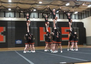 Members of the TKHS Cheer Team compete.