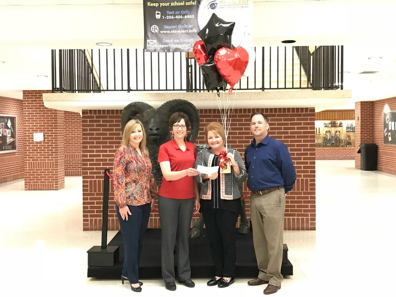 Stacey Fade receives scholarship from Community National Bank