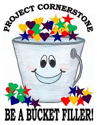 a bucket with a smiling face with bright colors bustiing