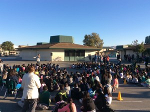 large group of students on blacktop for assembly, image 1