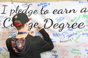 Junior pledging to get a college degree.