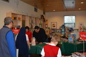 Parents cashiering at book fair.JPG