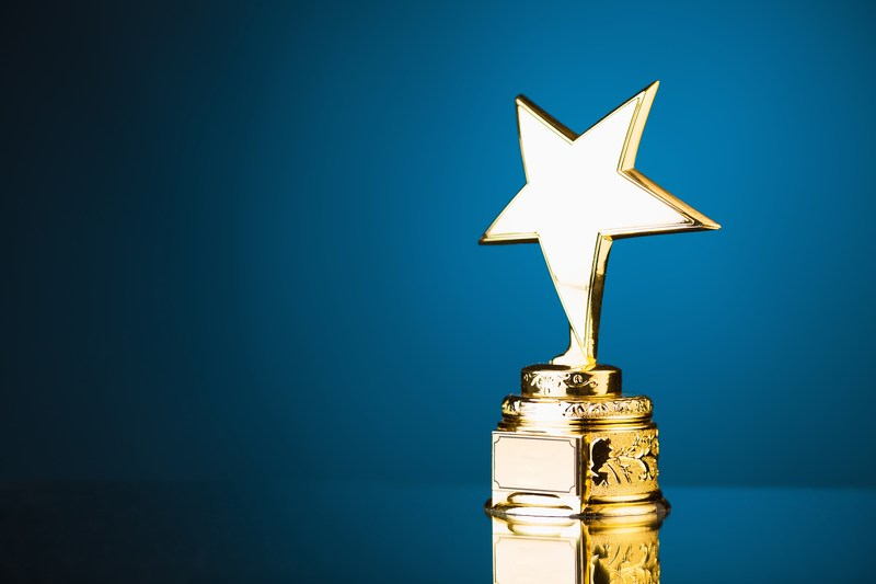 gold star award with blue background
