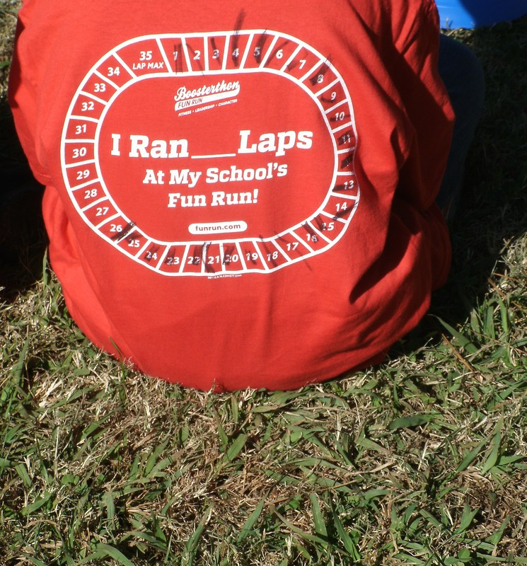 The back of a red Fun Run t-shirt worn by a child.
