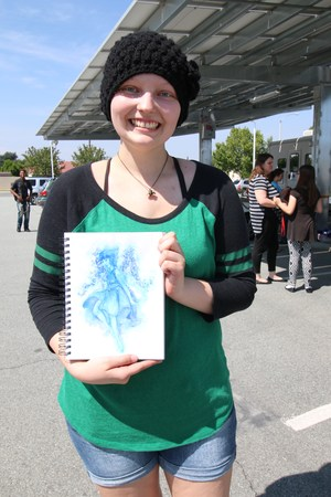 Cassi and one of her drawings