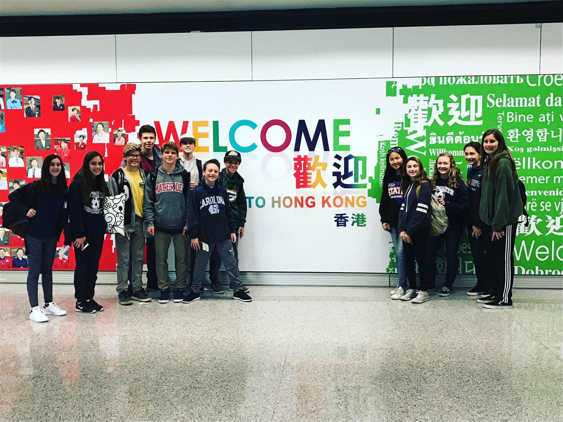 kids arriving at Hong Kong Airport