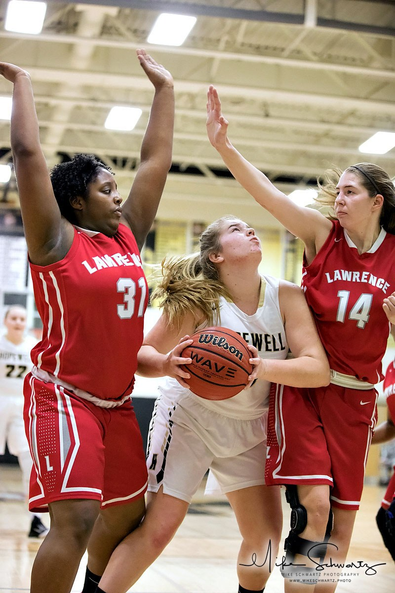 CHS girls basketball player looks toward the basket between two defenders