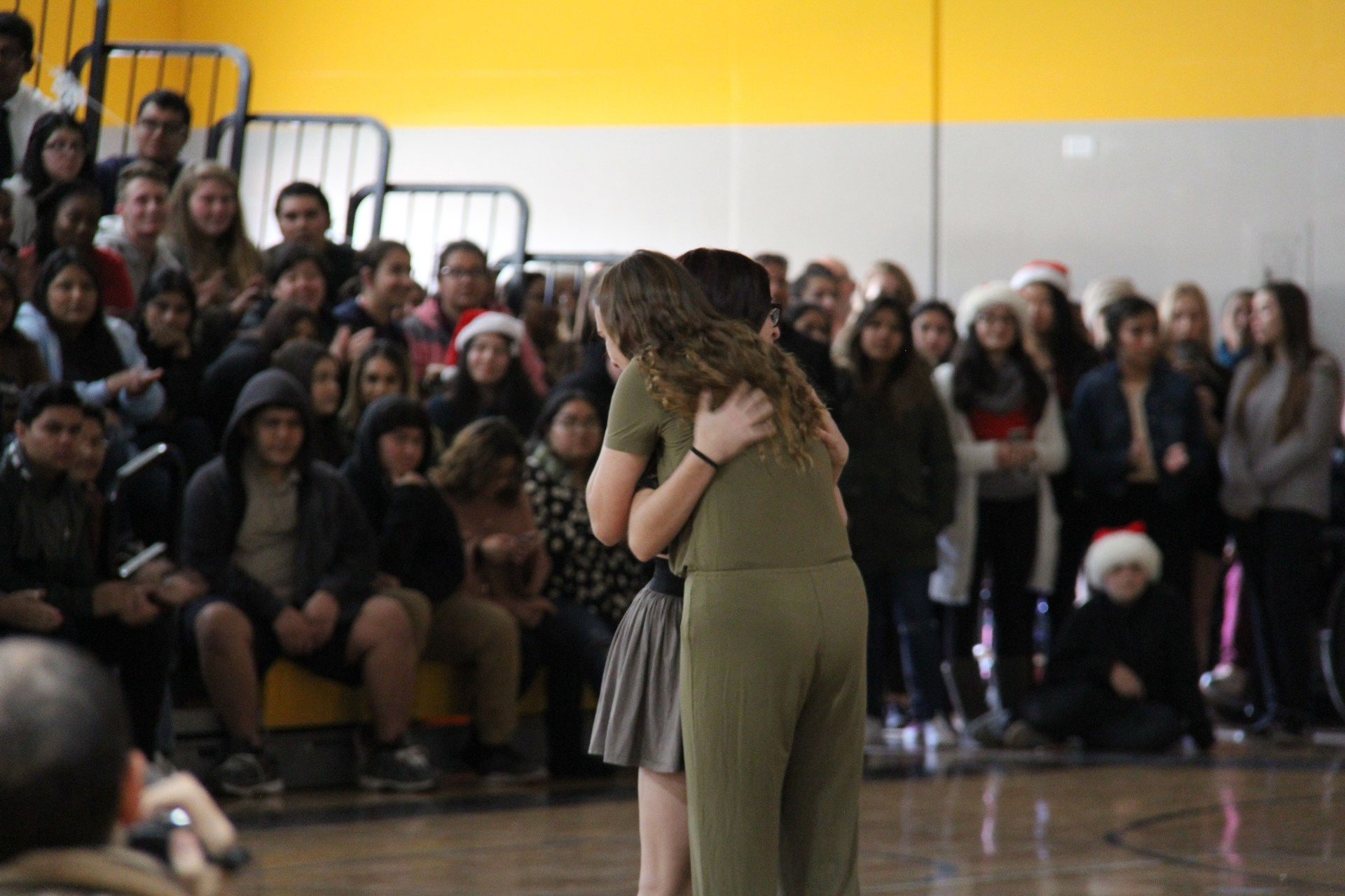 Image of students embracing during 2017 winter wishes event