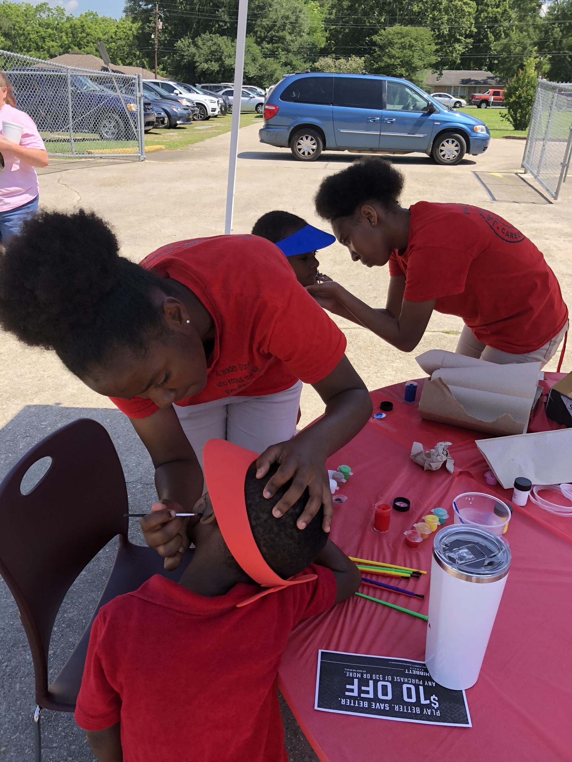 Photo of the Baker Middle JAGs rendering community service in field day at Bakerfield & Baker Heights Elementary Schools