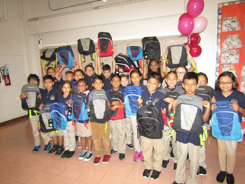 student showing off their backpacks from T Mobile