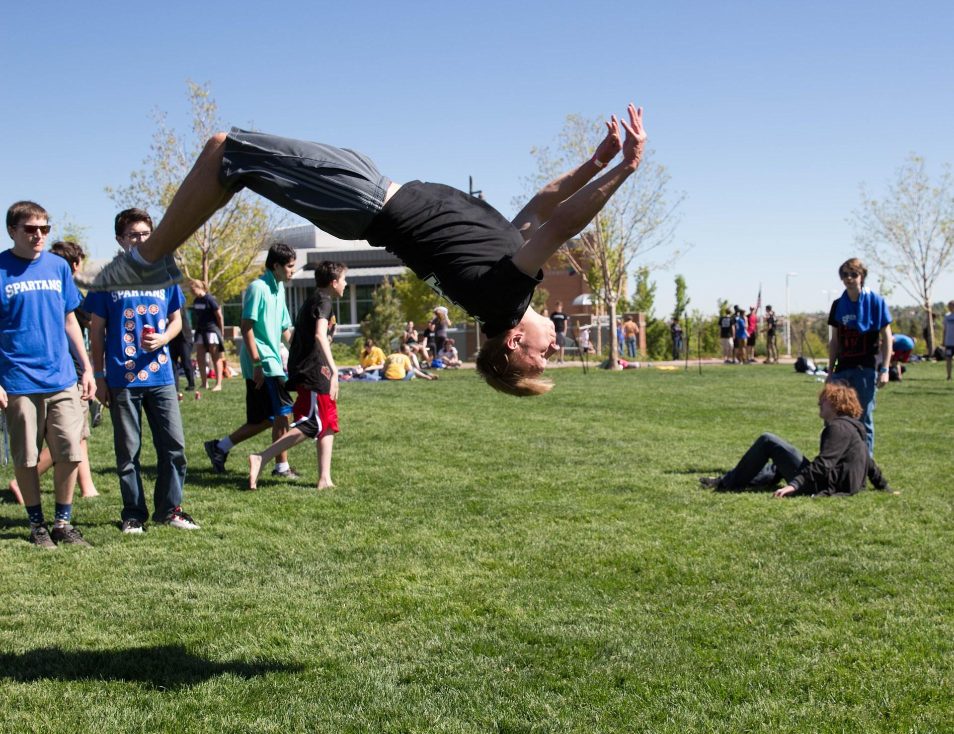 high school student doing a backflip