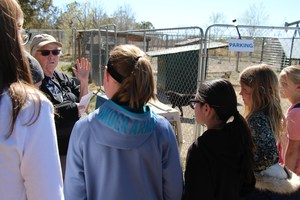 Anna talking to the students at Annie's Orphans.
