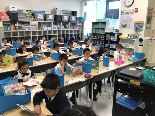 Students reading at their desks.